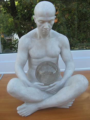 statue of a meditating man
